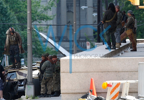 The Dark Knight Rises Set Photos from Location Shooting in Pittsburgh, Tom Hardy as Bane standing on a Tumbler that may or may not be a Batmobile