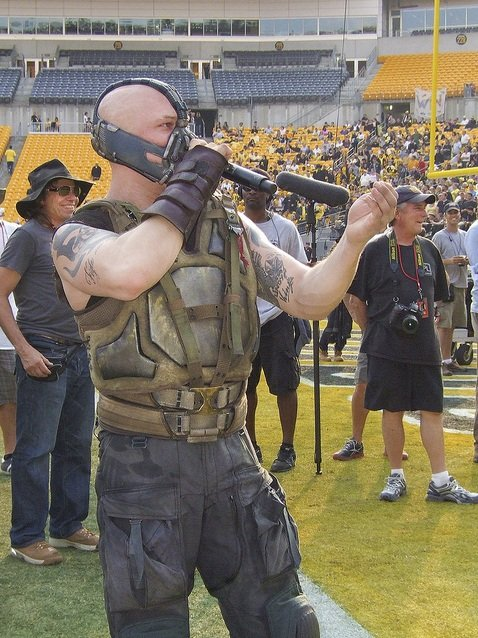 Tom Hardy as Bane, at Gotham Stadium (Heinz Field) during a Gotham Rogues football game