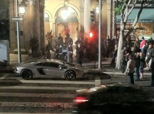 The Dark Knight Rises set photo: Bruce Wayne Arriving at a party in his new lamborghini