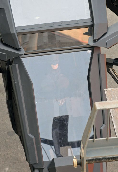 Christian Bale as Batman in the Batsuit on the set of The Dark Knight Rises in the Batwing